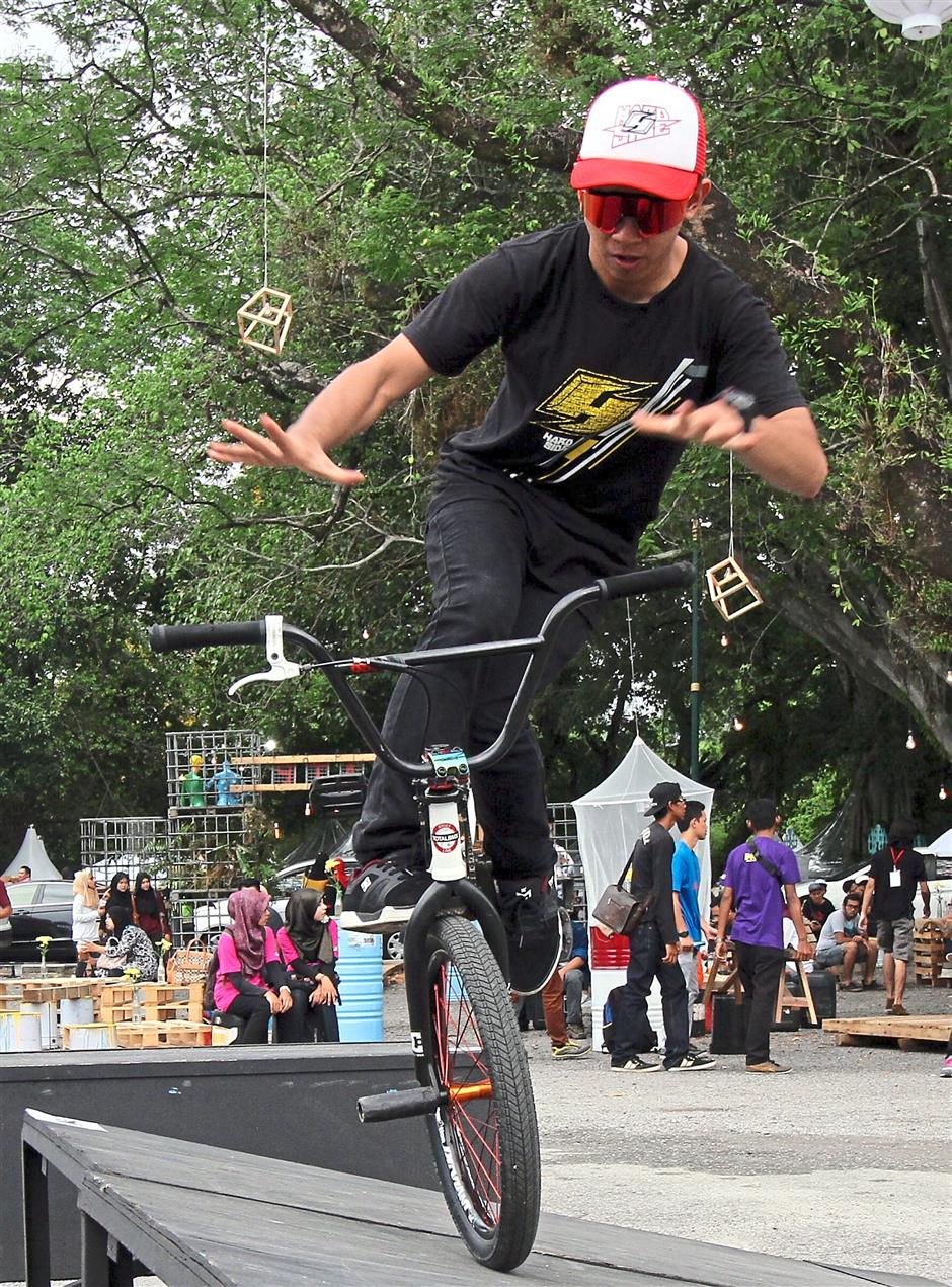 A BMX rider showing of his tricks.