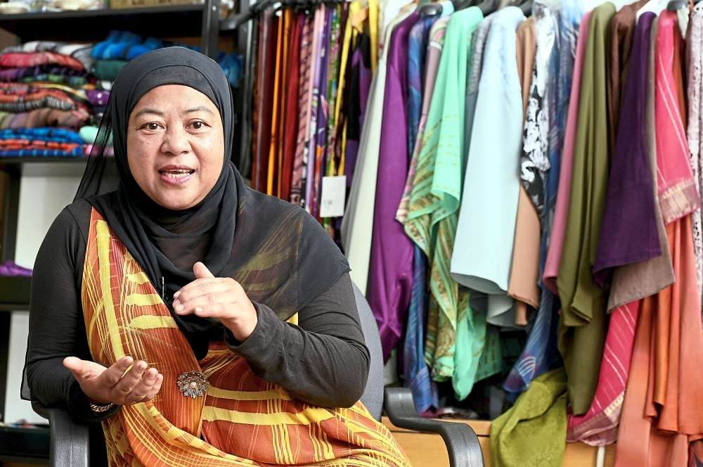 Masrina is passionate about drawing batik and preserving the artform.