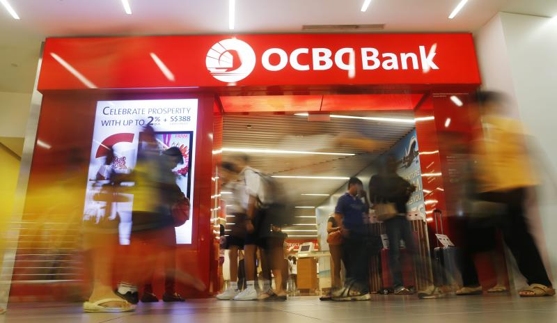 A branch of OCBC in Singapore. Bank of America Merrill Lynch (BofA), HSBC and J.P. Morgan are sharing equal underwriting of the loan for OCBC\'s takeover of Hong Kong-based Wing Hang Bank - EPA Photo.