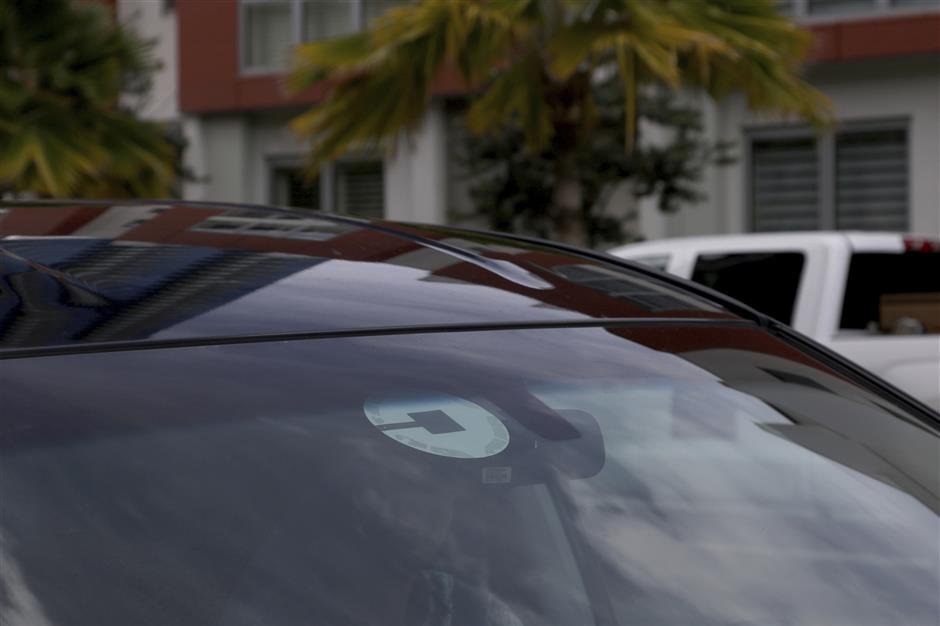 FILE- In this June 6, 2018, file photo Uber driver Joshua Oh drives in Honolulu. The 4G speeds, what we're used to today, made possible many of the things we now take for granted on our phones, Instagram, cloud storage, Netflix. Also, for instance, that ride you got home from the bar. (AP Photo/Caleb Jones, File)