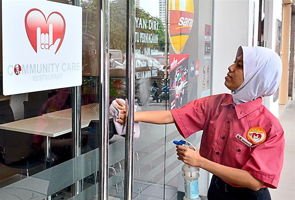Suhaila Sutaji a deaf and mute and she works at KFC Sentul Raya.