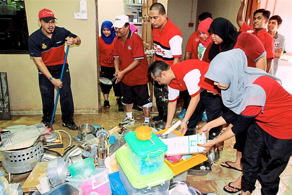 Still good: Kolej Komuniti Kuala Kangsar students and lecturers helping to clean their college bakery's utensils and kitchenware.