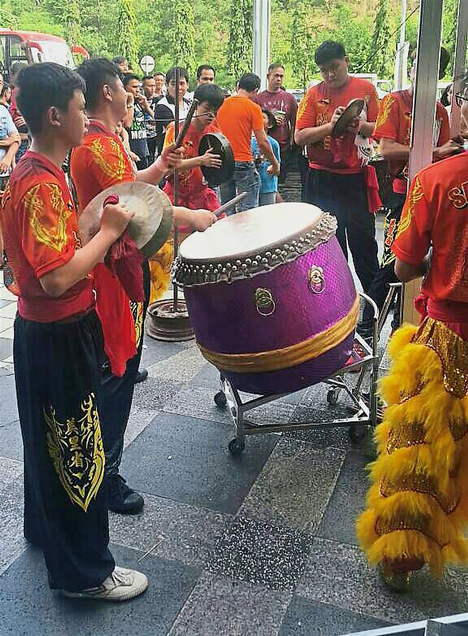 Drummers and cymbal players on standby for the lion dance competition.