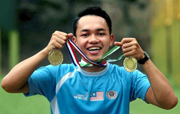 On the double: Mohd Lutfi Othman won gold in the 50m rifle three position individual and team event.