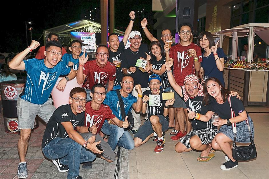 Parkson Card Members who won lucky draw prizes rejoice at the viewing party in Puchong.