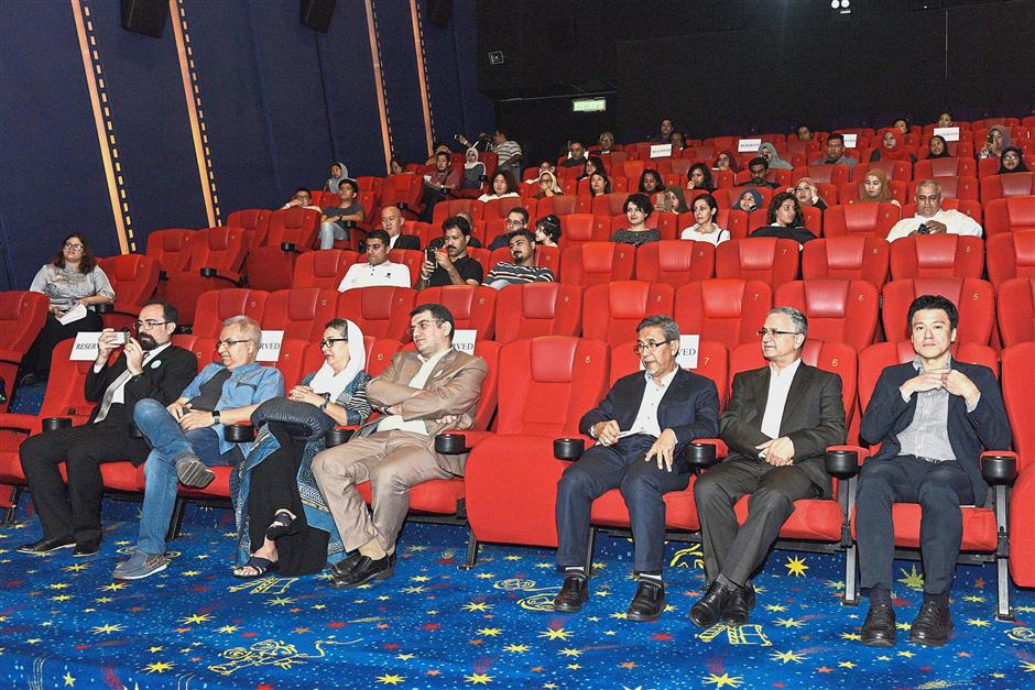 Dignitaries and guests enjoying the screening of a movie at the launch of the Iranian Film Festival Malaysia 2018 at GSC Gurney Plaza in Penang.