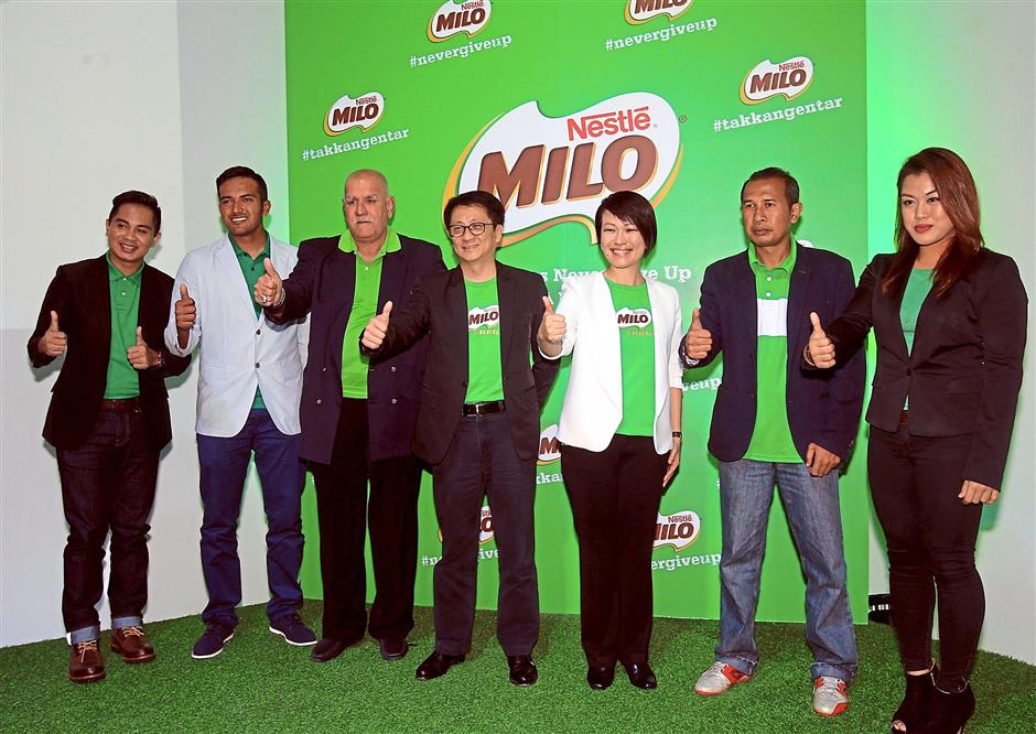 1 Giving the thumbs up (from left) 'Takkan Gentar' host Adi Fashla, Khairulnizam, Santokh, Nestle communications director Khoo Khar Khoon, Tan, Ombak FC coach Mus and Ann.2 Tan and Khoo (fifth and sixth from left) with the Ombak boys.3 Singer Hazama Azmi performing the theme song of the series.4 Malaysia's first female MMA fighter Ann Osman at the campaign launch. Photos: ART CHEN