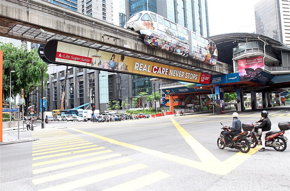 Train service: Monorail running through Jalan Sultan Ismail while MRT is being constructed.