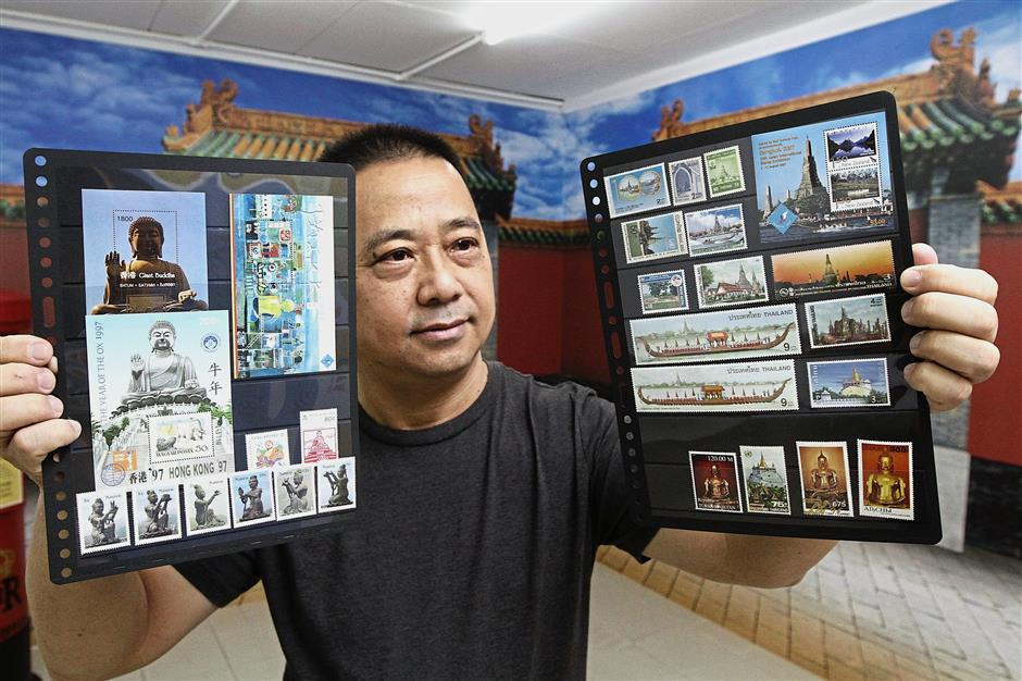 Yeoh showing some of the stamps featured at the Buddhist stamps gallery in Yayasan Belia Buddhist Malaysia in Seang Teik Road. (Top left and below) Closeup view of some of the stamps on display at the gallery. — Photos: LIM BENG TATT/The Star