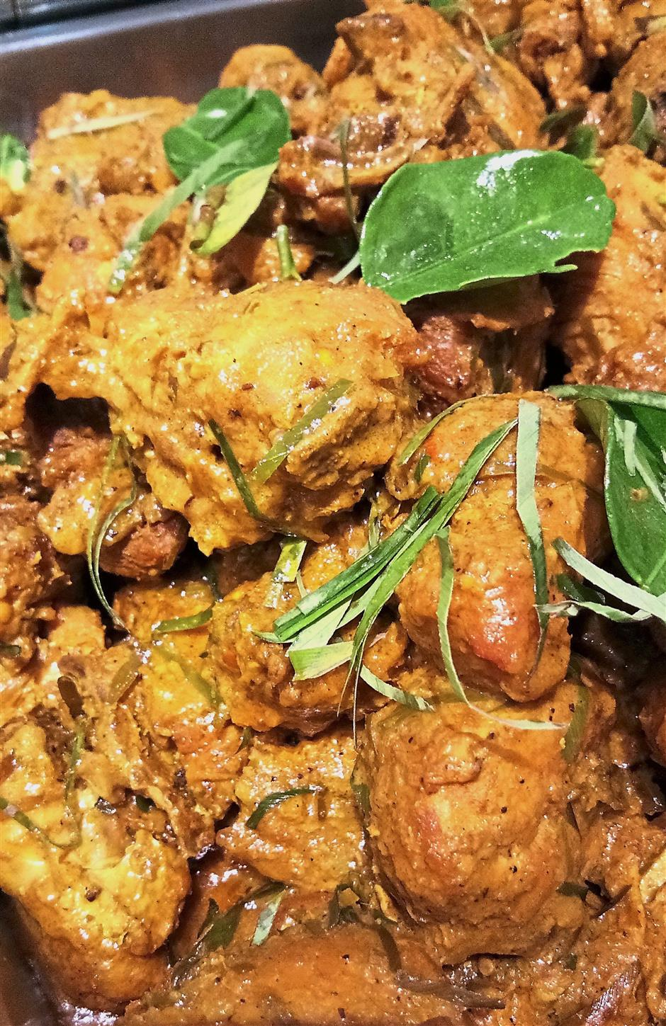 Norashikeen's Minang-style chicken rendang is a family recipe.