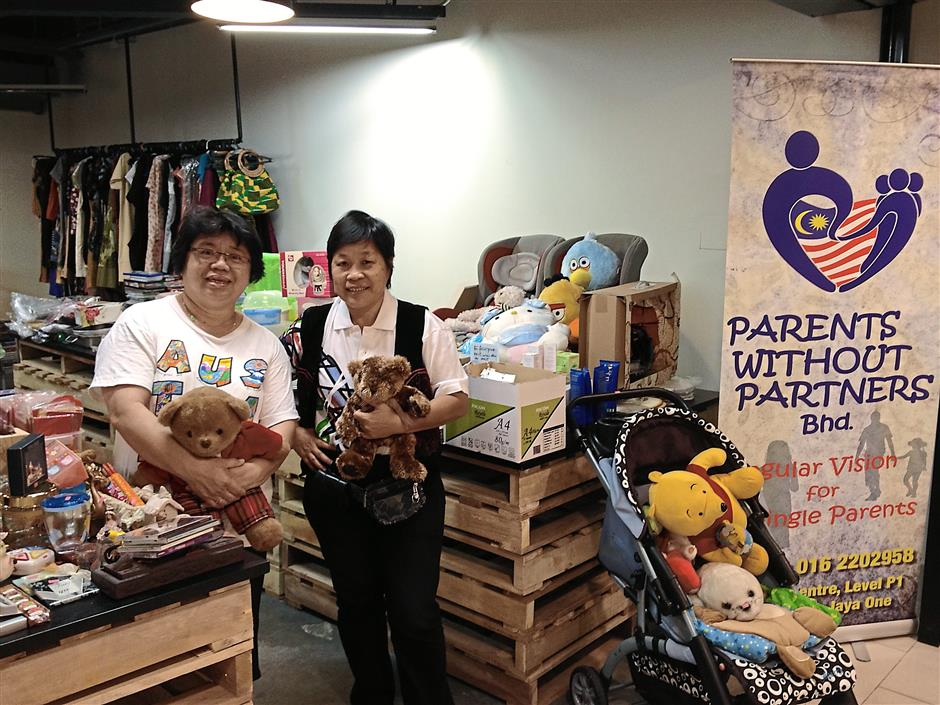 Parents without Partners founder and director Tan with co-director Julie Tan at the Jumble Station in Jaya One, Selangor. Photo: MARY ANNE TAN