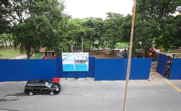 Hoarding surrounds the Pengkalan Batu Park that is under construction beside Sungai Klang.