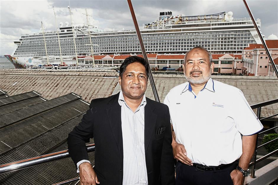 Plans for the future: ufeffSasedharan, seen here ufeffwith chief operating officer Radhi Mohamad at Swettenham Pier, says he expects business to be good over the next three years.