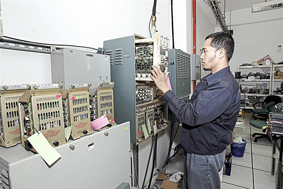 An AMP technician testing radar equipment at the company's test lab in its headquarters in Shah Alam.
