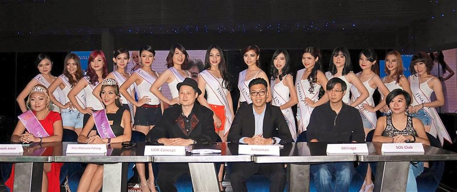 Big event: Wee (front row, third from left) and Chan (front row, third from right) with the 14 finalists of Miss Andaman World. With them are (front row, from left) Miss Malaysia Sabah Queen Sheba, Miss Malaysia Pahang Leng Sean, iMiirage manager Lawrence Pu2019ng, and Sensation of Sound managing director Yinyi Wong.