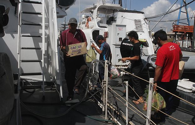 Malaysia Maritime Enforcement Agency reloading their boat at Tok Bali APMM base before continuing the search operation for MAS MH307 plane reported missing.