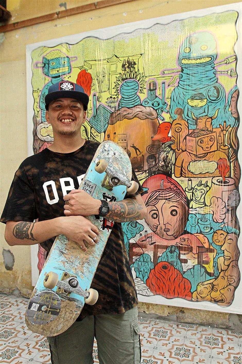 1 A participating artist setting up a skate ramp, while others go for a spin.2 Skate artist Donald Abraham Gadius Painus Munsih, better known as Yakyak, posing with his untitled piece depicting worldly distractions beyond a skateboard park.