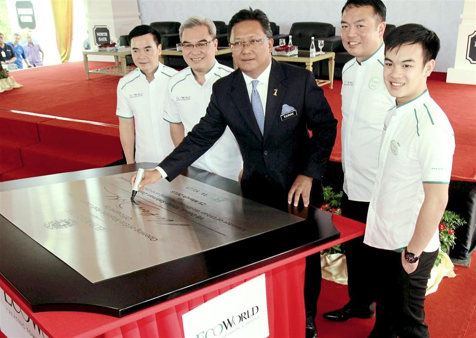 It's official: Abdul Rahman (centre) signing the plaque to officiate the opening of the Eco Majestic Red Carpet Bridge. With him are (from left) EcoWorld executive director Datuk Voon Tin Yow, Liew, Chang and EcoWorld executive director Liew Tian Xiong.