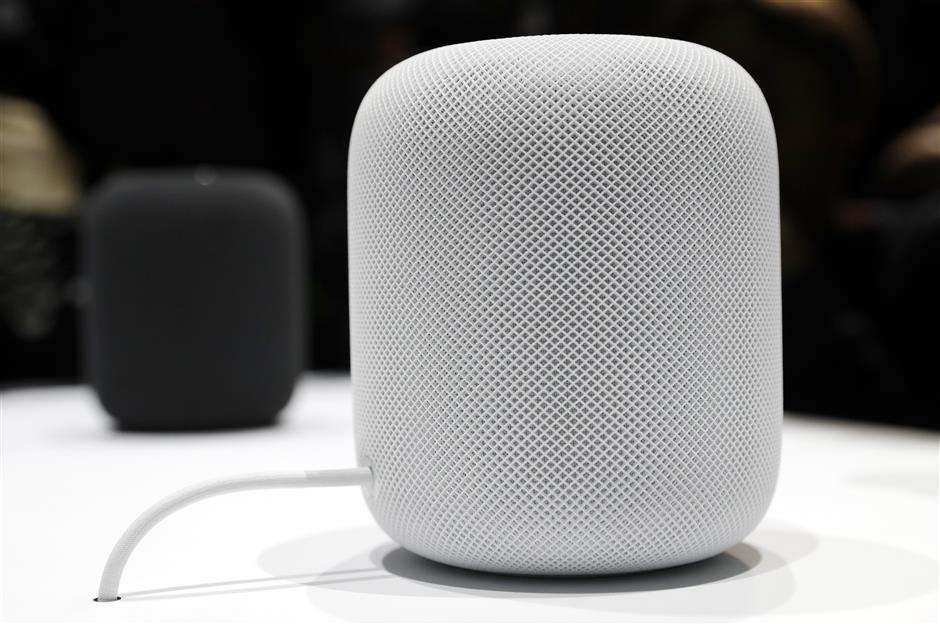 FILE - In this Monday, June 5, 2017, file photo, the HomePod speaker appears on display during an announcement of new products at the Apple Worldwide Developers Conference in San Jose , Calif. Pre-orders for the HomePod will begin Friday, Jan. 26, 2018, in the U.S, U.K. and Australia, two weeks before the speaker goes on sale in stores. (AP Photo/Marcio Jose Sanchez, File)