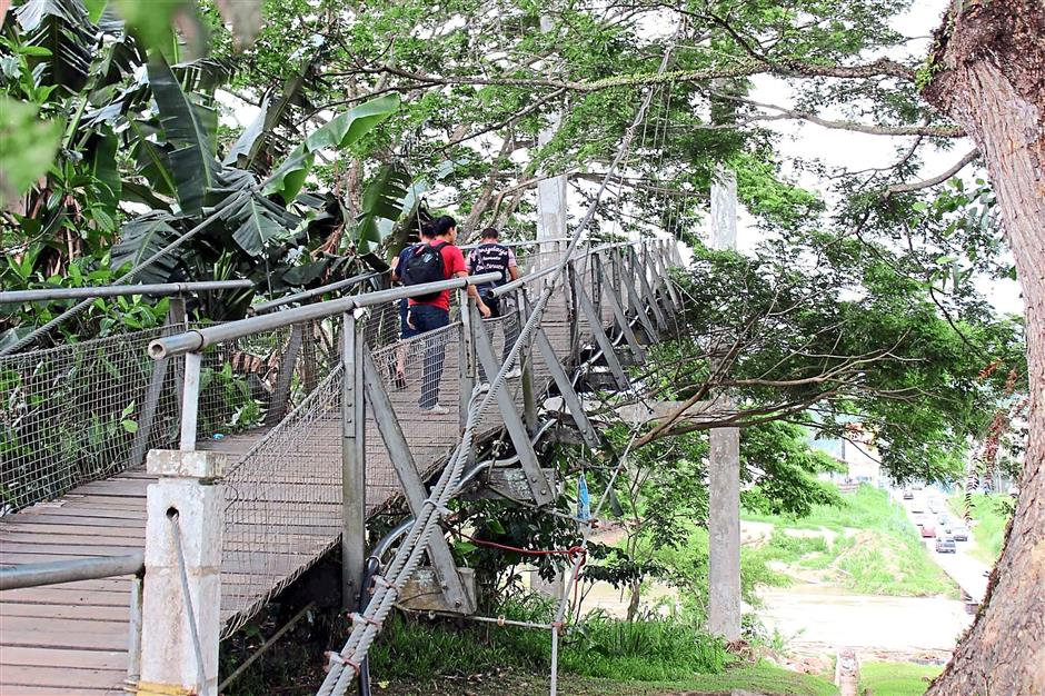 Town's pride: The Jambatan Tamparuli suspension bridge, made famous by a folk song of the same name, is popular with tourists to the town.