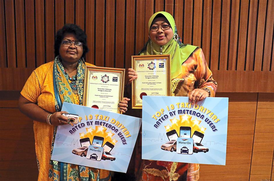 Anjalai (left) and Nur Azeela are the two women out of 10 taxi drivers who were rated as the top 10 drivers via SPAD's app called MeterOn.
