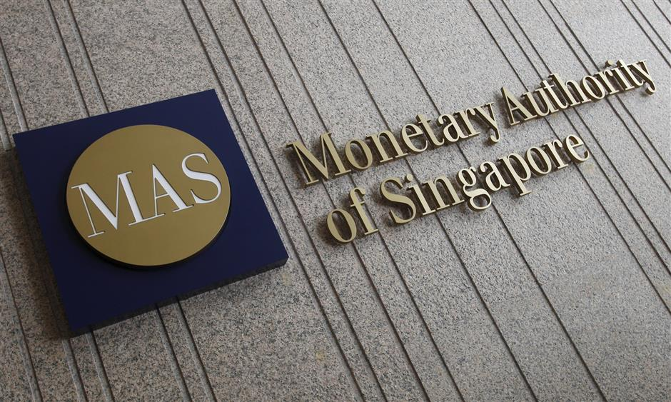 The logo of the Monetary Authority of Singapore (MAS) is pictured at its building in Singapore in this February 21, 2013 file photo.  REUTERS/Edgar Su/Files THE ASIA FILE OCT 27 2015