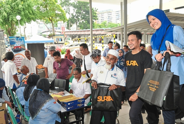 Taxi drivers registering for the Self-Employed Employment Injury Scheme at Larkin Sentral in Johor Baru.