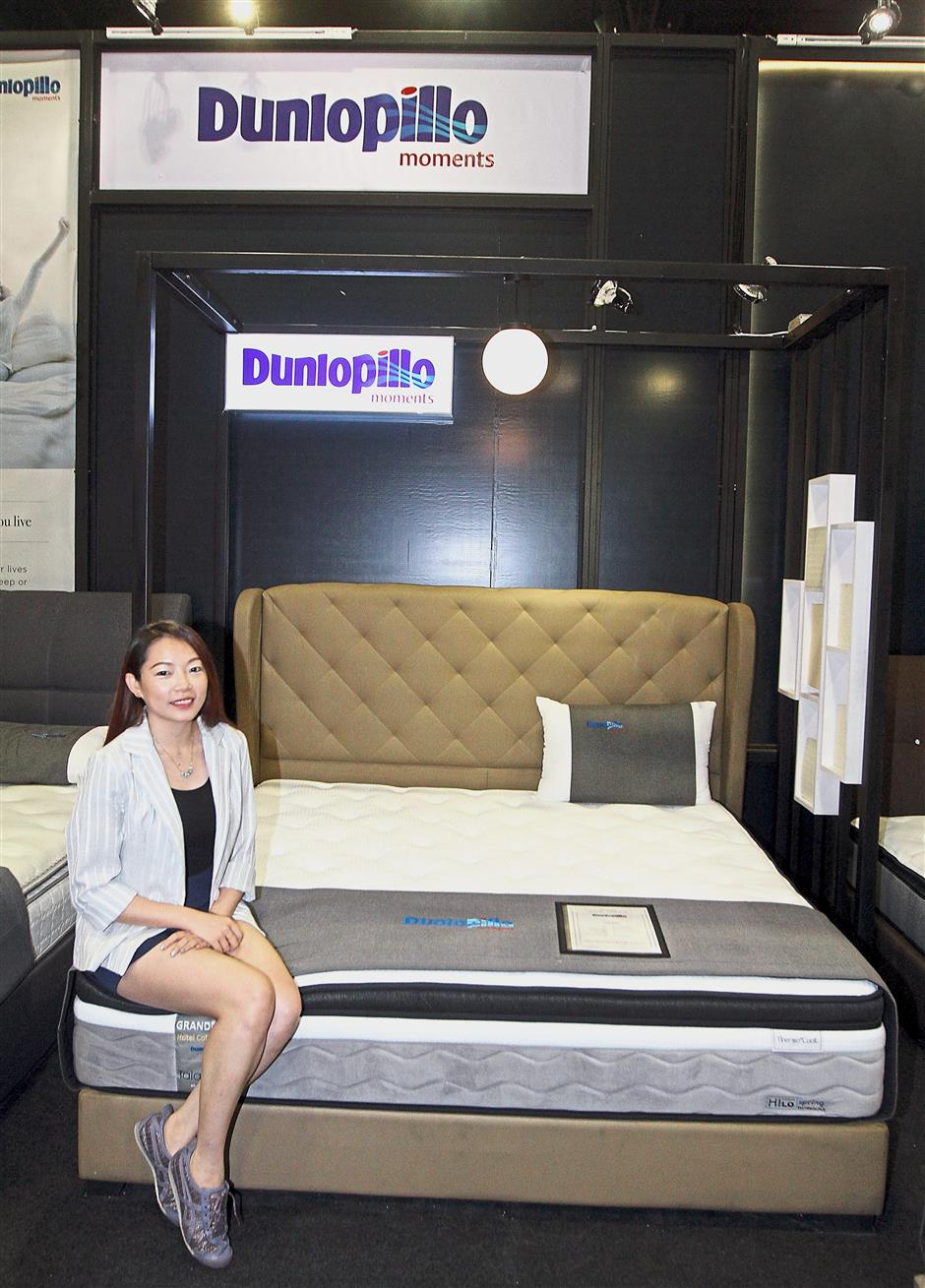Lim sitting on a Hotel Collection series mattress, the latest product by the company.