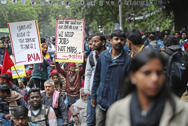 Students from various organisations participate in a demonstration demanding more job opportunities in New Delhi, India. Every year, 10-12 million young people flood the job market, however, in 2018 alone, 11 million jobs were lost. - AP