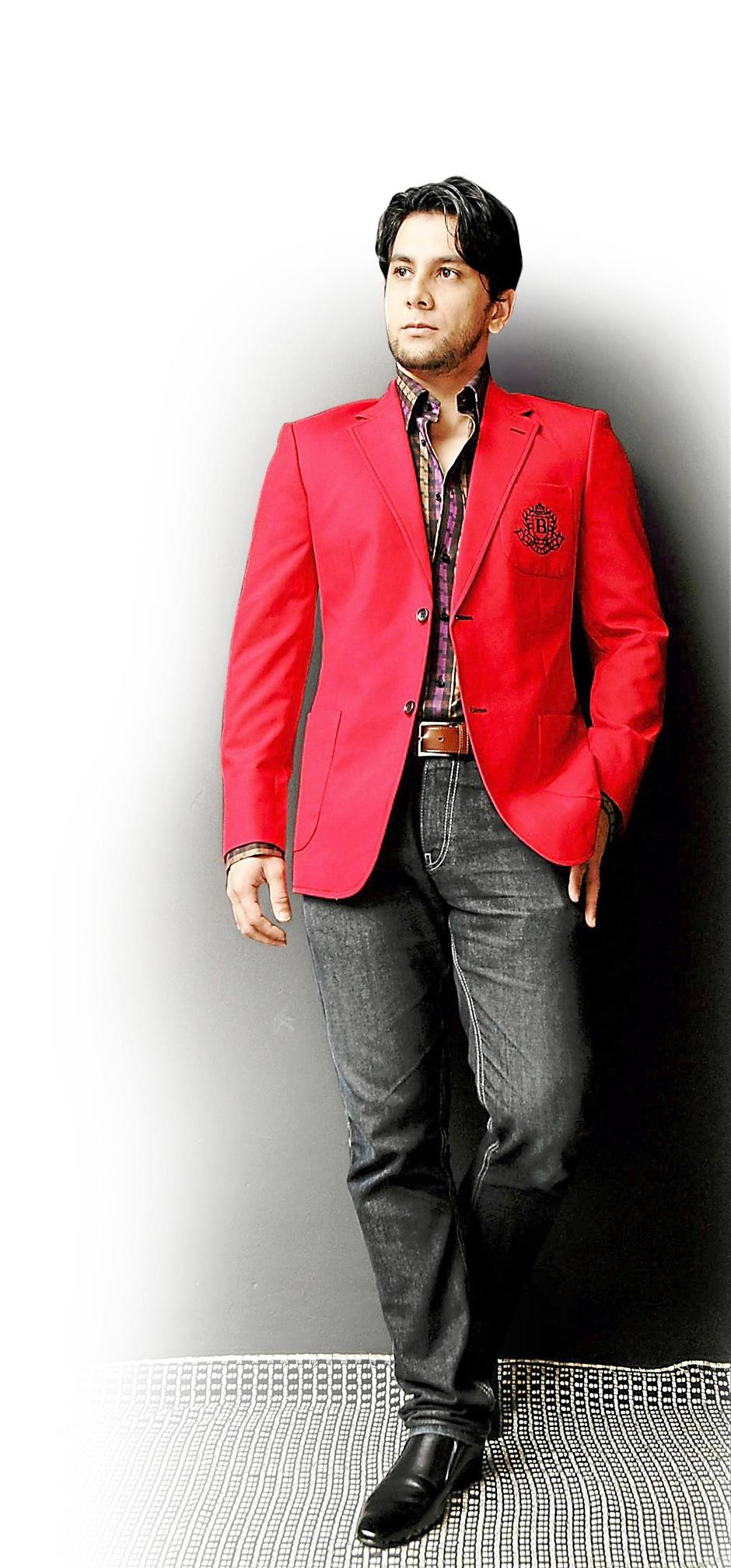 Director, actor, producer and writer Sein dresses up his outfit with a standout jacket from Bon Zainal.