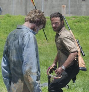 Rick Grimes (Andrew Lincoln) faces off with a walker in the new season of <i>The Walking Dead</i>.