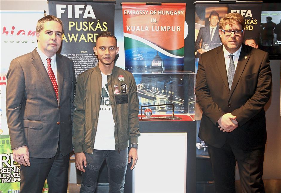 (From left) Hungarian ambassador to Malaysia Attila Kali, FIFA Puskas 2016 award winner Mohd Faiz and Szllosi. — Photo: M.AZHAR.ARIF/The Star