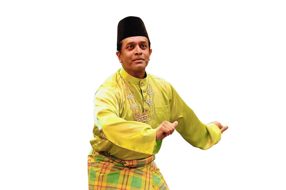 Cultural understanding: Dr Gonzales performing a traditional Malay dance in 2011. He believes that embracing another culture is vital in today's Malaysia.