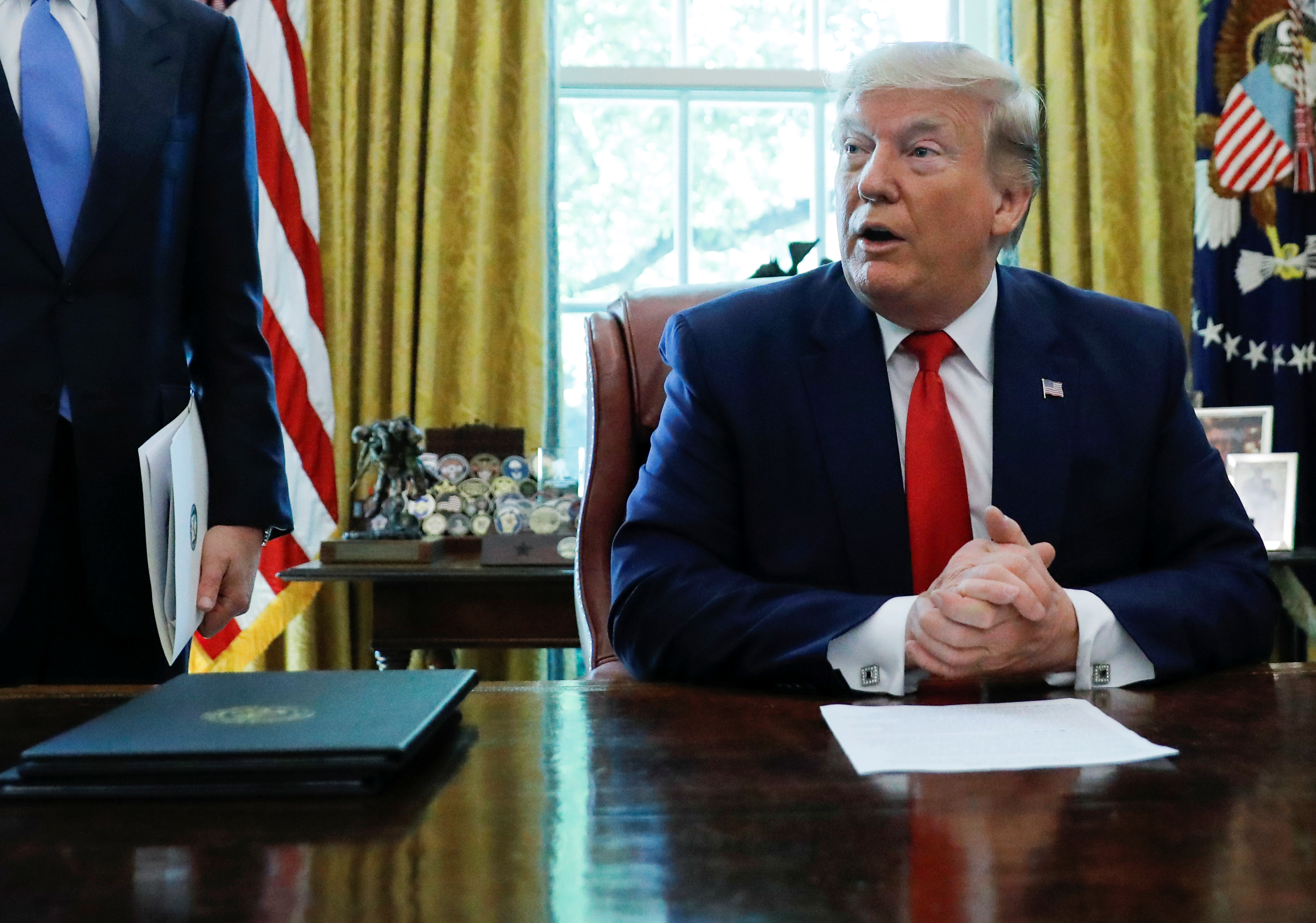 FILE PHOTO: U.S.  President Donald Trump talks about the United States imposing fresh sanctions on Iran before signing an executive order in the Oval Office of the White House in Washington, U.S., June 24, 2019. REUTERS/Carlos Barria