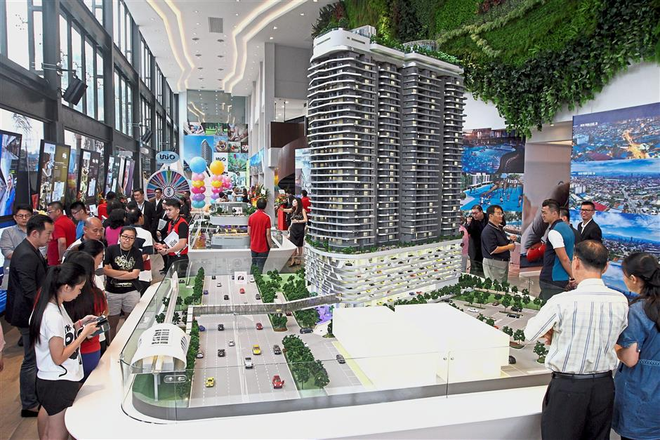 Visitors viewing a model of the Unio Residence at the sales gallery in Kepong.