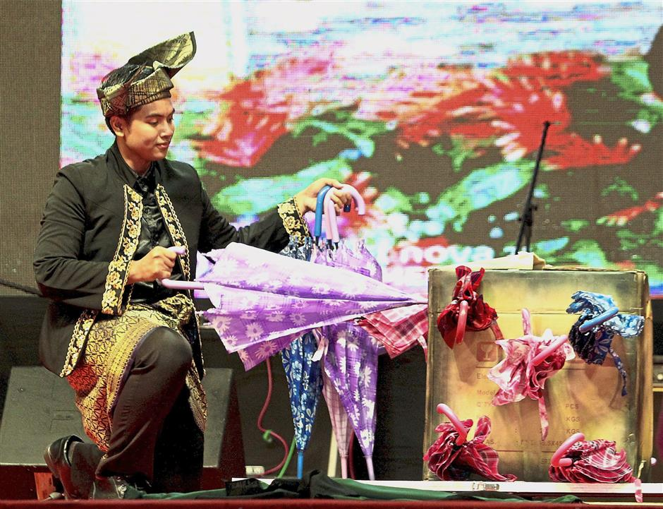 A magic show performance by Hakim during the state-level Malaysia Day celebration in Taiping.