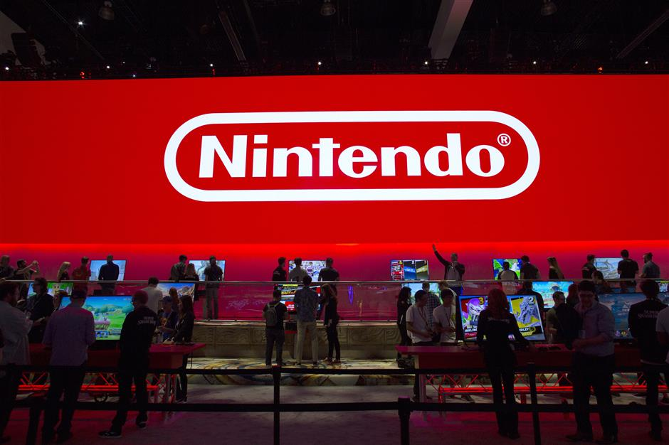 Attendees play the Nintendo Co. Super Smash Bros. Ultimate at the company's booth during the E3 Electronic Entertainment Expo in Los Angeles, California, U.S., on Tuesday, June 12, 2018. Nintendo announced a slate of new titles for its new hybrid console Switch, moving to capitalize on early excitement for its newest system. Photographer: Troy Harvey/Bloomberg