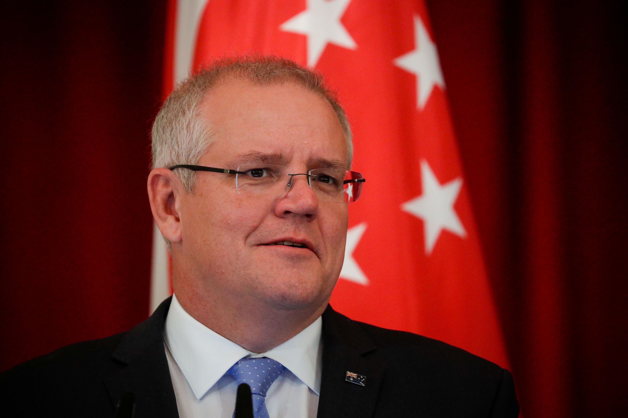 FILE PHOTO: Australian Prime Minister Scott Morrison speaks during a joint press conference at the Istana Presidential Palace in Singapore, 07 June 2019. Wallace Woon/Pool via REUTERS