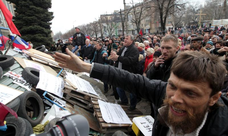 Supporters at a rally in front of the security service building occupied by Pro-Russian activists in Lugansk, Ukraine, on April 14, 2014. The pro-Russian activists occupying state institutions said they would not heed the ultimatum by the government in Kiev despite being warned of a military operation against them - EPA Photo.