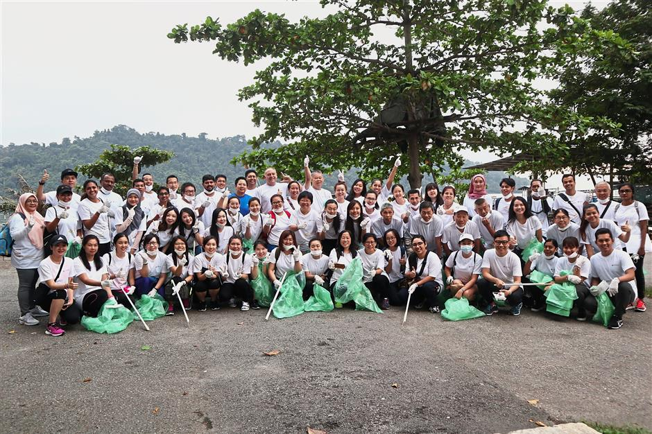 Hotel Equatorial volunteers gathering for a group photo before commencing the community walk and clean-up programme.