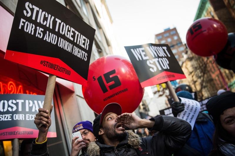 Protesters march through the streets demanding a raise on the minimum wage to $15 per hour on Dec 4, 2014 in New York, US. In constant dollars the average hourly salary of US$20.67 in the US is barely higher than the US$19.18 of 1964 - AFP Photo.