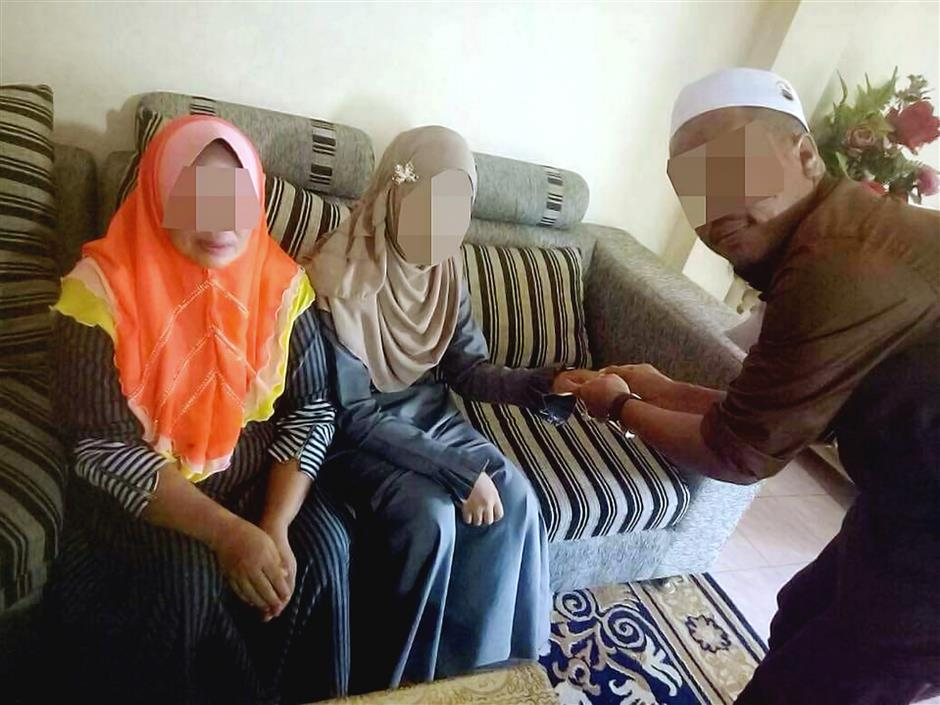 Goodbye childhood: The man meeting his bride in Gua Musang, Kelantan.