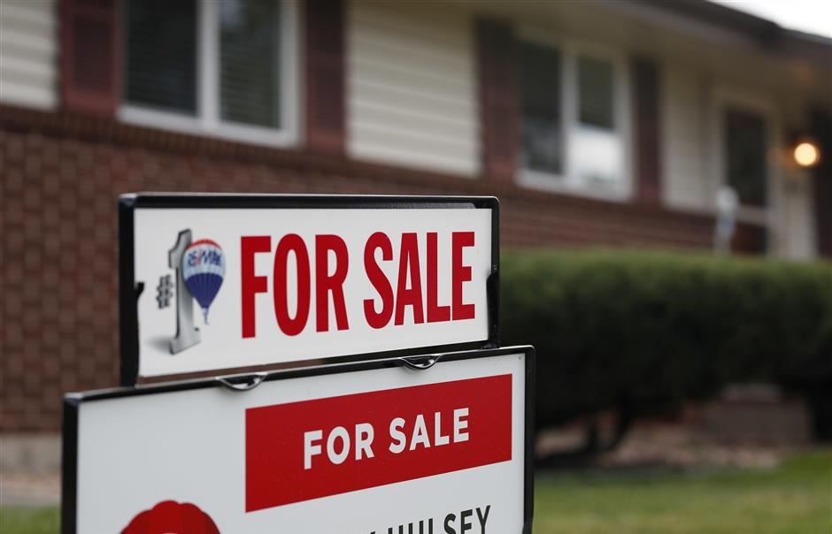In this Oct 2, 2018, photo, a for sale sign stands outside a home on the market in the north Denver suburb of Thornton, Colo. The National Association of Realtors issues its tally of December home sales Tuesday, Jan. 22, 2019. (AP Photo/David Zalubowski)