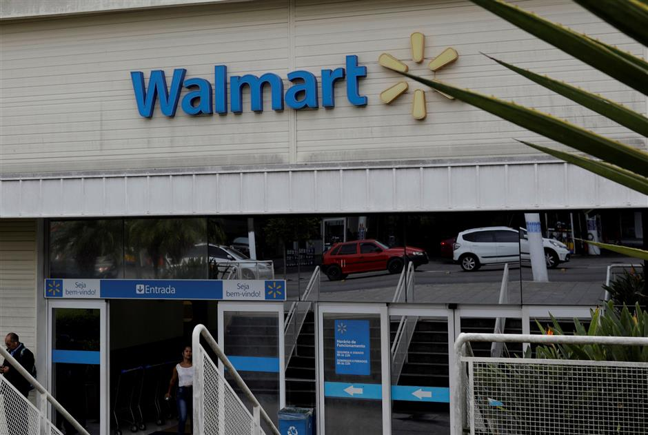 FILE PHOTO: The main entrance to a Walmart store is pictured in Sao Paulo, Brazil February 14, 2018. REUTERS/Paulo Whitaker/File Photo