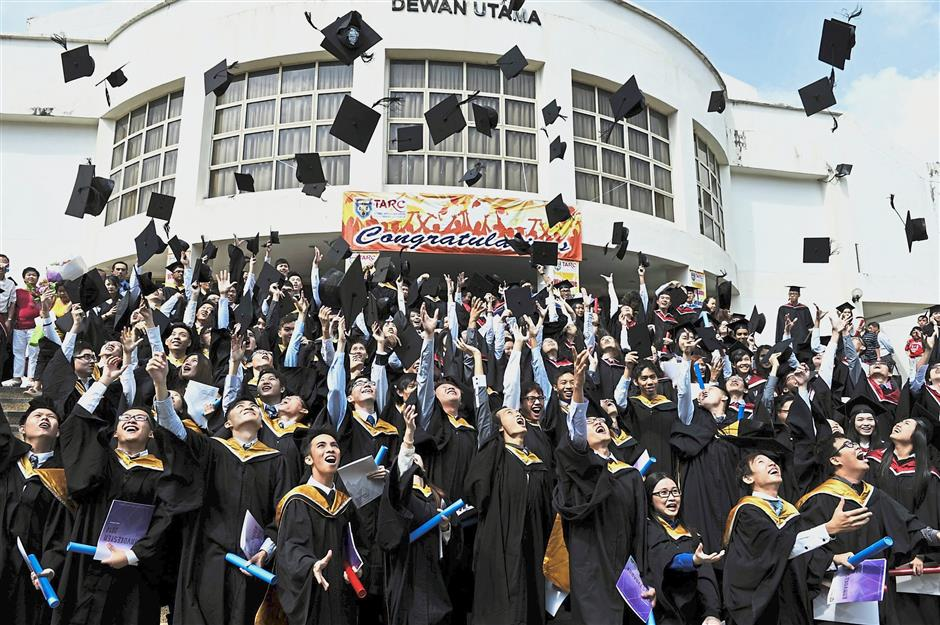 Proud tradition: Students celebrating graduation at a Tunku Abdul Rahman University College campus. TAR UC is, says the letter writer, u2018An institution that has provided excellent futures for hundreds of thousands of graduatesu2019.