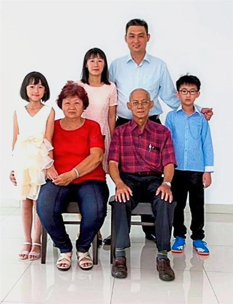 Devastating fate: The Fire and Rescue Department believes that Swee Boku2019s family members only woke up after the fire engulfed most of the house. His father had died recently of cancer.