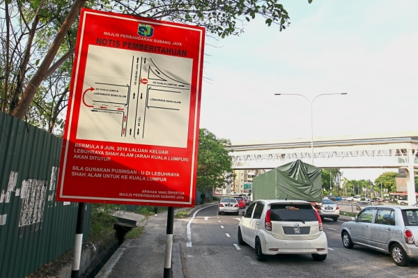 The three-phase traffic management system for Persiaran Kewajipan, which was  implemented in August last year, is set to continue. u2014 filepic