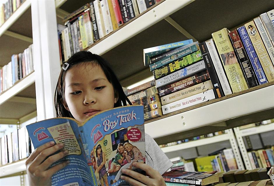 Promoting reading habit: The Subang Jaya Book Exchange Programme is a community initiative that allows children like Loh Ving Yue, 10, to exchange and read books for free.