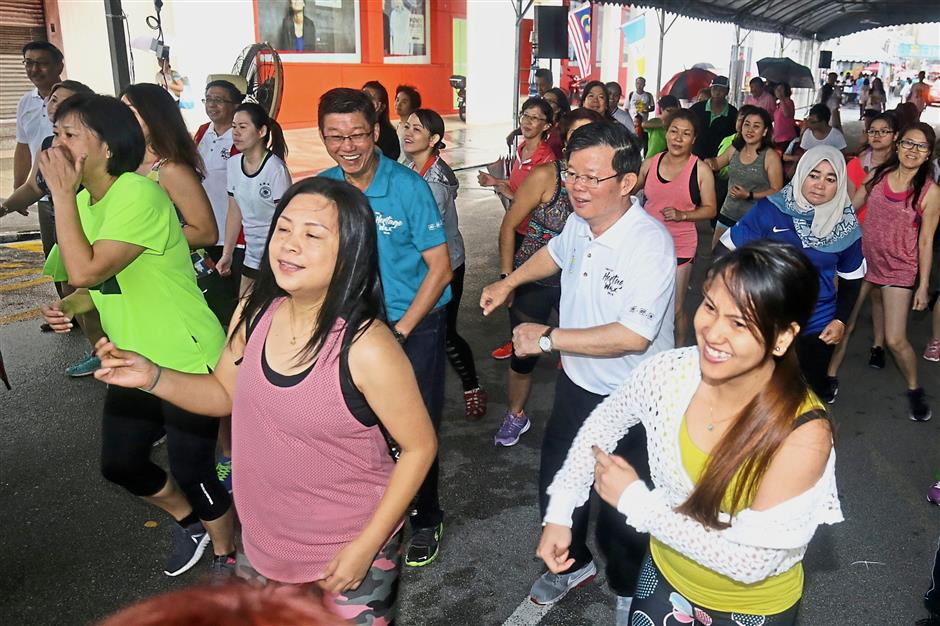 Chow (white T-shirt) joining participants in a Zumba session during the event.
