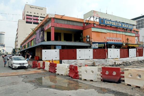 Hoardings have been put up outside Emporium Makan in anticipation of the demolition.